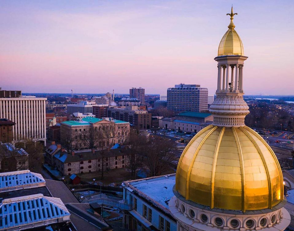The top of the NJ State Capitol building and city skyline