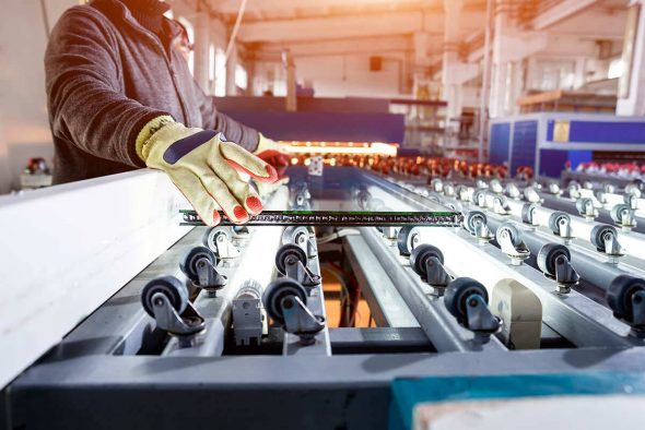 Worker at a factory manufacturing cart systems
