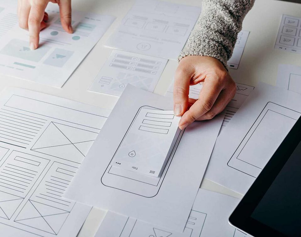 A UX designer working on low-fidelity, paper wireframes