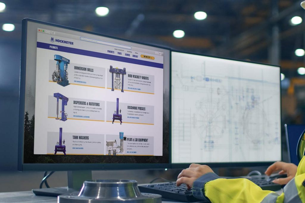 Image of a worker looking at a Product Listing custom web design for Hockmeyer Equipment Corporation