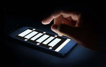 Hand scrolling through texts on smartphone
