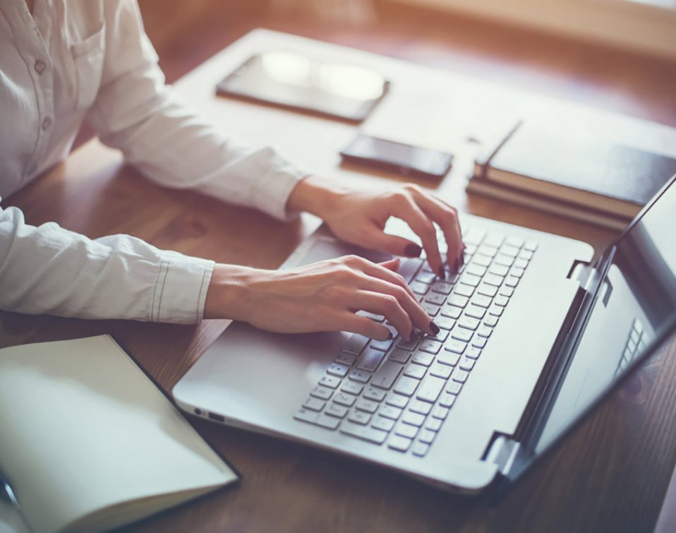 Writing copy on laptop