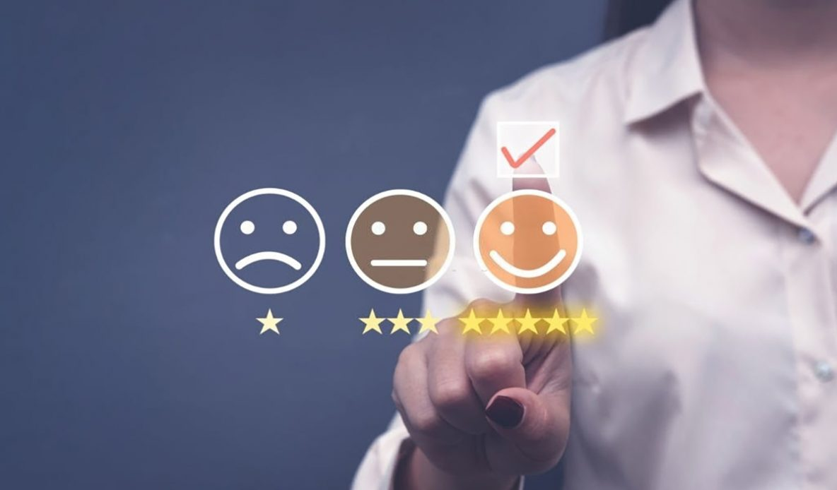 Person touching icon of happy face