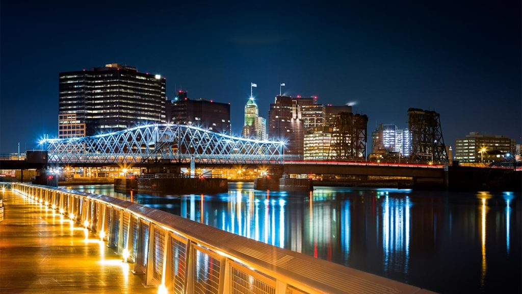 Skyline of Newark NJ at night from the Hudson Waterfront