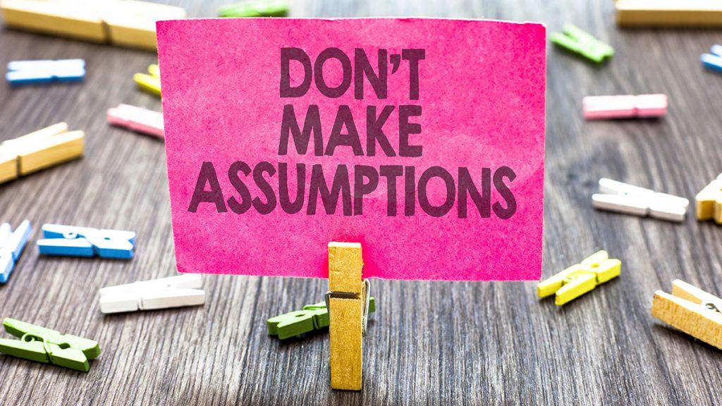 sign saying don't make assumptions