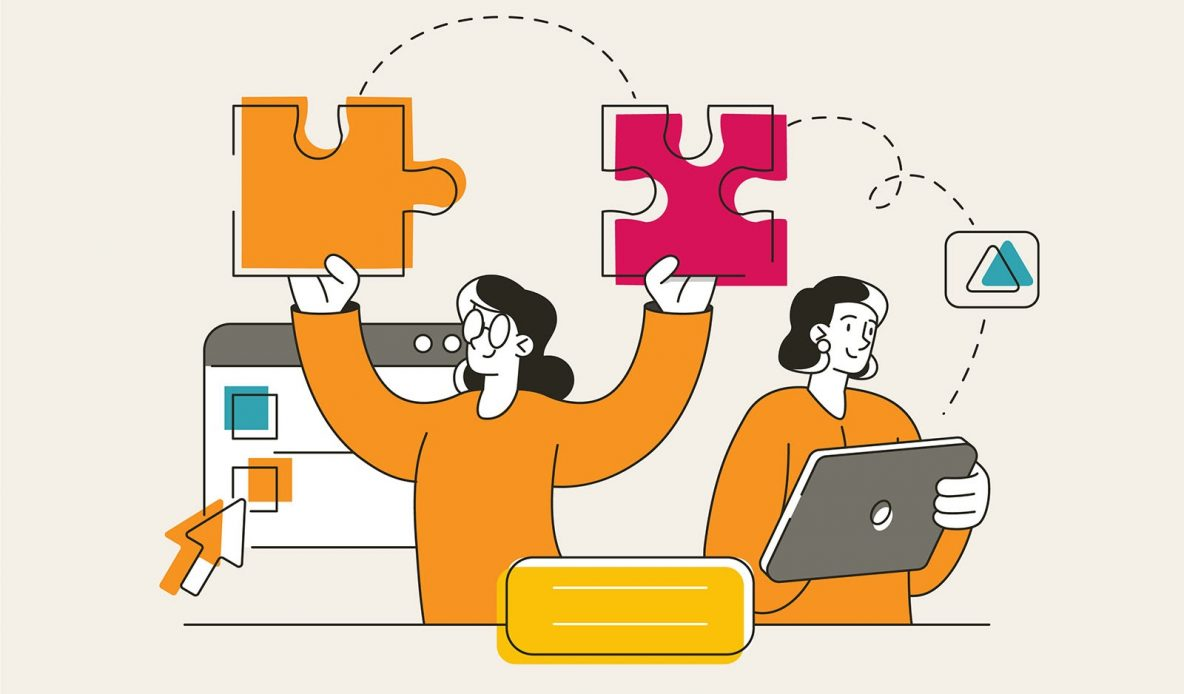 one person holding two pieces of a puzzle and another person holding and looking at a screen